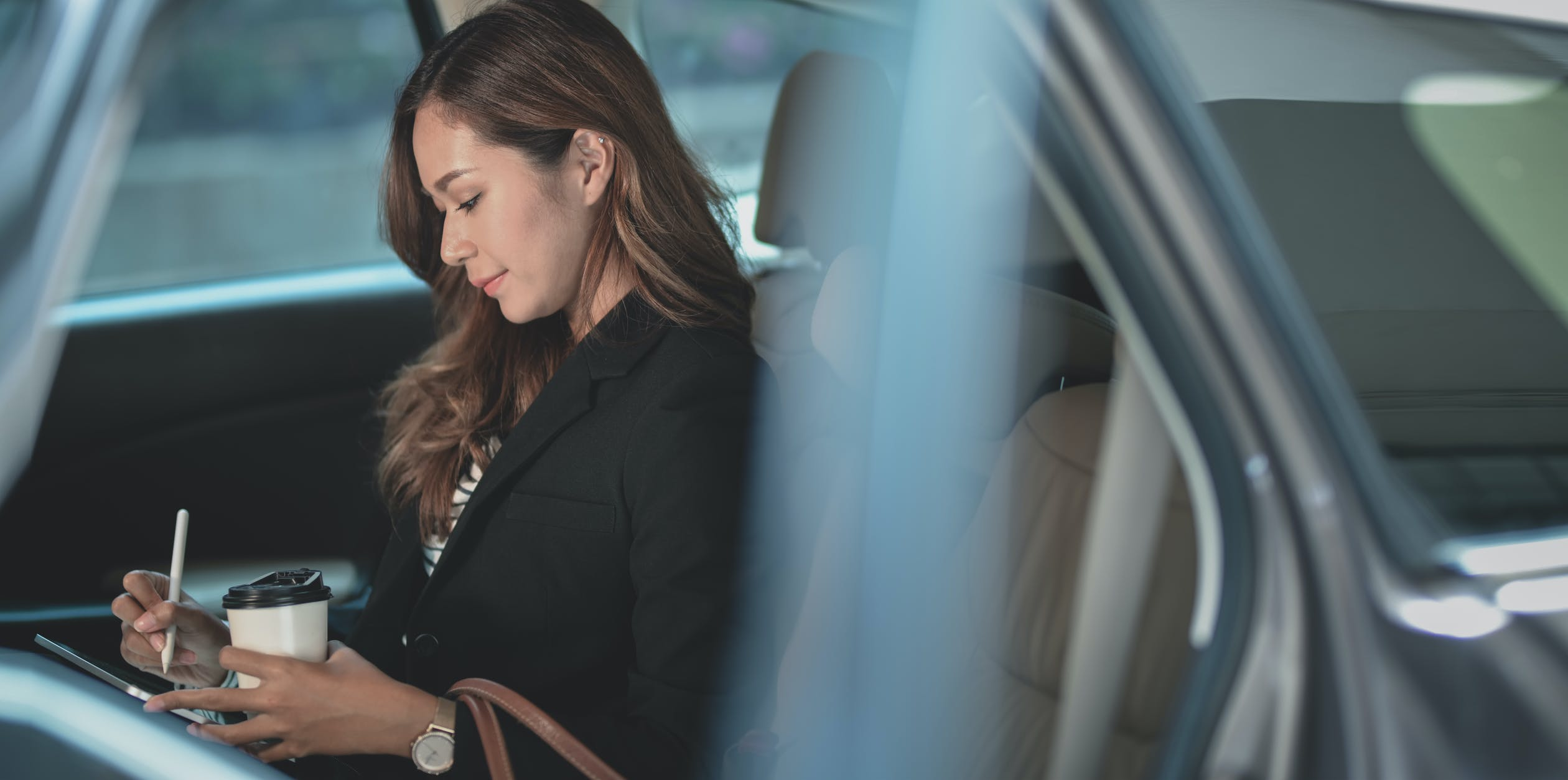 business woman working in car