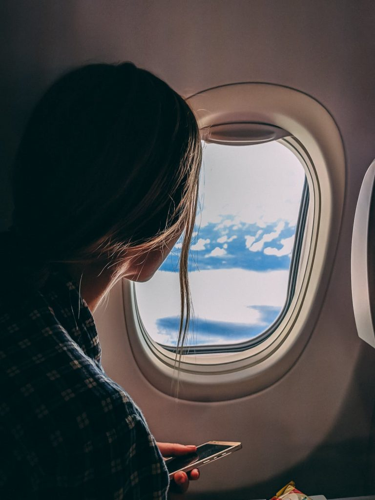 Woman looking out of airplane